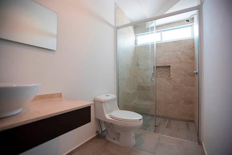 Baño: Baños de estilo  por JF ARQUITECTOS