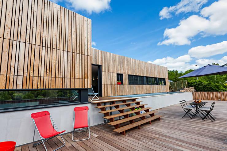 Terraços  por Hugues TOURNIER Architecte