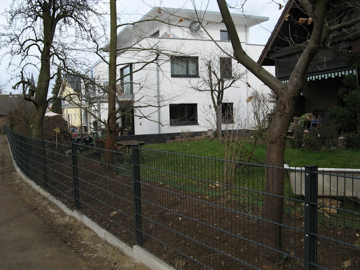 Houses by STRICK  Architekten + Ingenieure, Modern