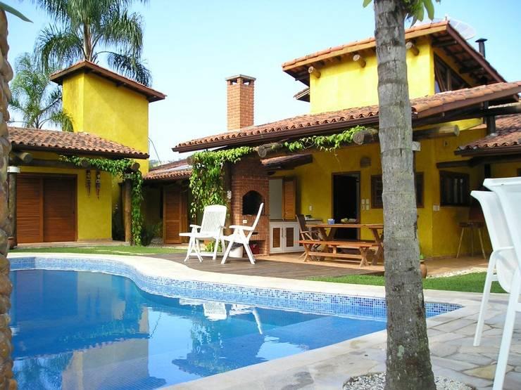 Casa em Juquey: Casas  por Metamorfose Arquitetura e Urbanismo