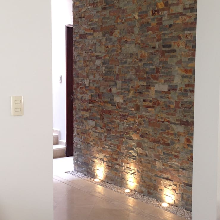 Projekty,  Korytarz, przedpokój zaprojektowane przez Alejandra Zavala P.