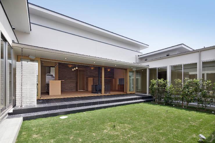 姫路市T邸: 空間工房 用舎行蔵 一級建築士事務所が手掛けた庭です。
