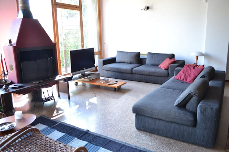 Casa Bressan: Soggiorno in stile  di Studio Thesia Progetti