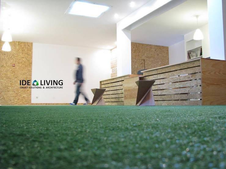 Novas instalações (Loja/Escritório): Escritórios e Espaços de trabalho  por Idealiving