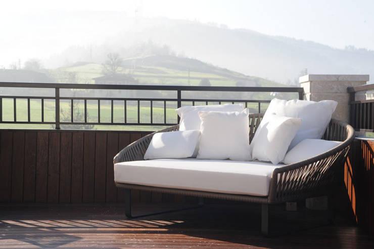 Sube Susaeta Interiorismo y Sube Contract diseño interior de casa con terraza: Terrazas de estilo  de Sube Susaeta Interiorismo