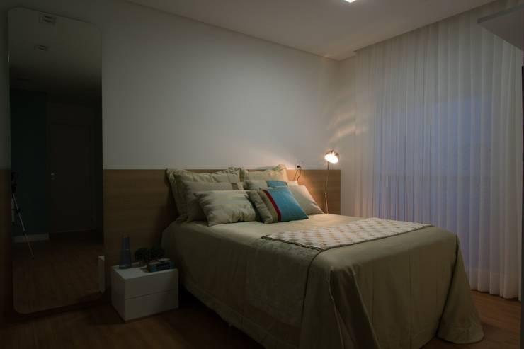 Apartamento Jacob : Quartos  por Estúdio Kza Arquitetura e Interiores
