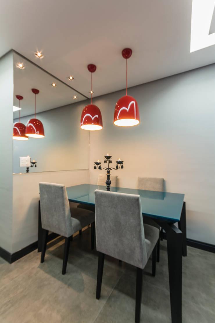 Gran Village Club: Salas de jantar  por Lo. interiores,Moderno