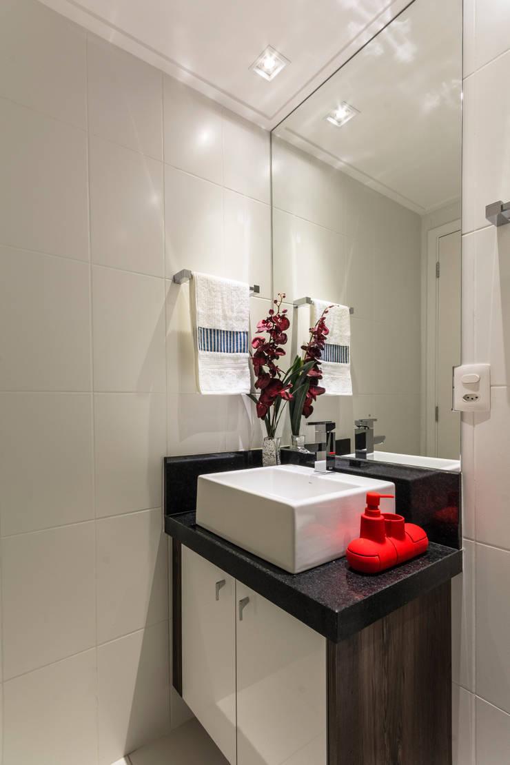 Gran Village Club: Banheiros  por Lo. interiores,Moderno