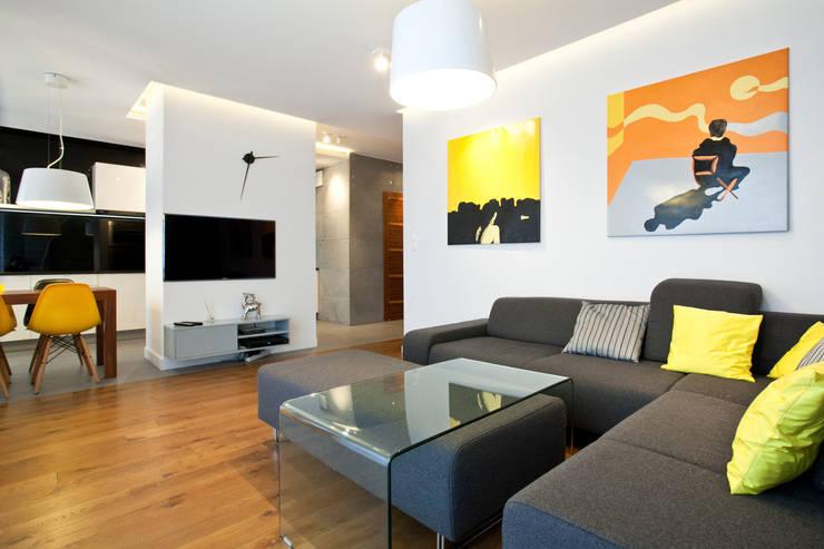Realizacja projektu mieszkania 54 m2 w Krakowie: styl , w kategorii Salon zaprojektowany przez Lidia Sarad,Minimalistyczny