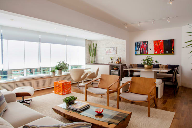 Apartamento Vila Olímpia: Salas de estar  por Helô Marques Associados