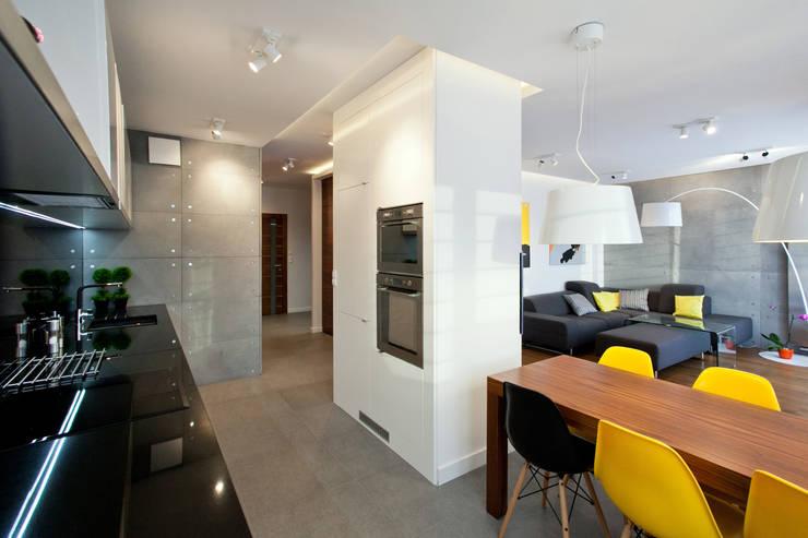 Realizacja projektu mieszkania 54 m2 w Krakowie: styl , w kategorii Jadalnia zaprojektowany przez Lidia Sarad,Minimalistyczny