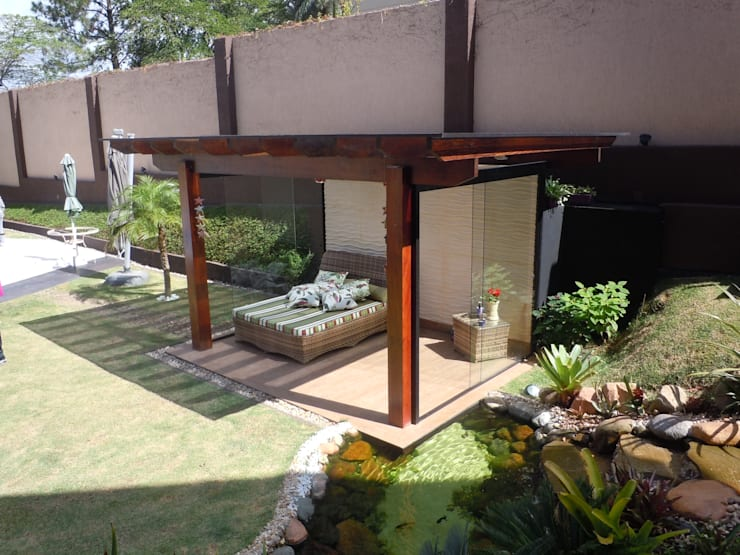 Pergolado: Terraços  por Flávia Brandão - arquitetura, interiores e obras