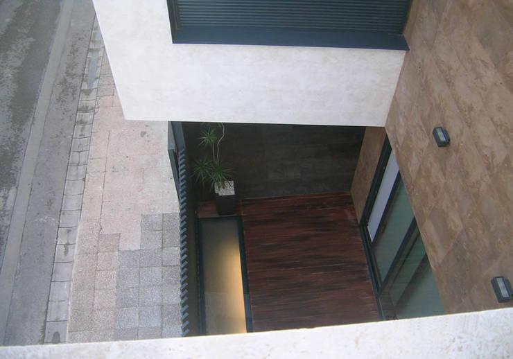 vivienda_unifamiliar_puçol_foto_exterior_4: Casas de estilo  de aguilar avila studio