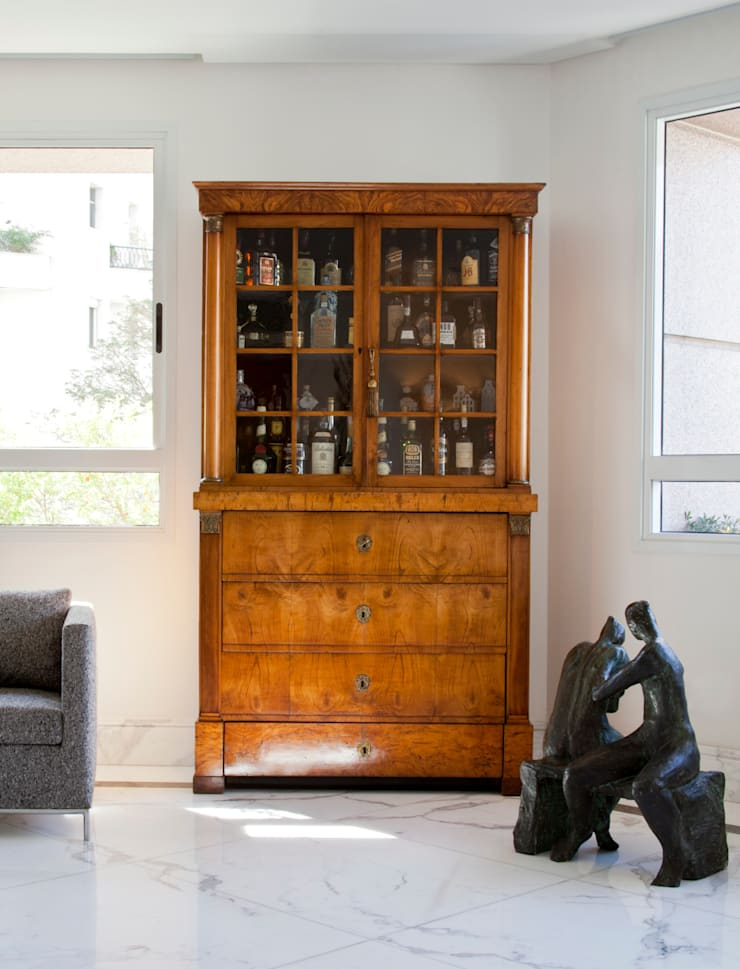 VNC APARTAMENTO : Salas de estar modernas por Noura van Dijk Interior Design