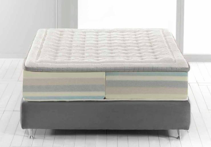 DUAL CONCEPT: Camera da letto in stile in stile Moderno di MAGNIFLEX