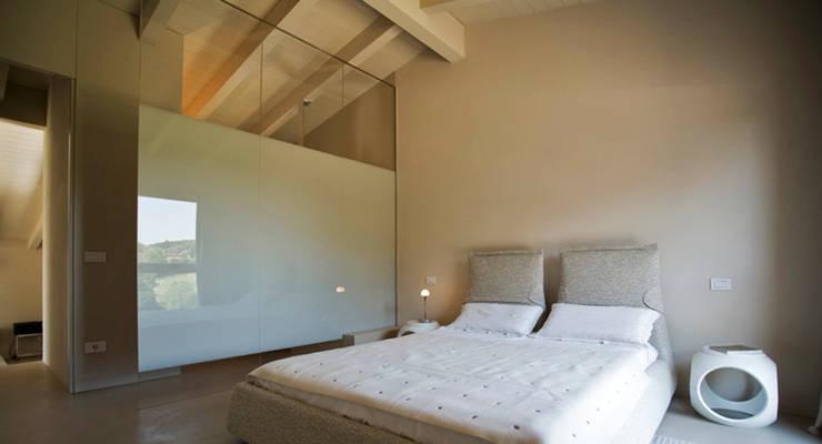 Casa Manfredi _ casa manfredi: Camera da letto in stile  di LDA.iMdA architetti associati