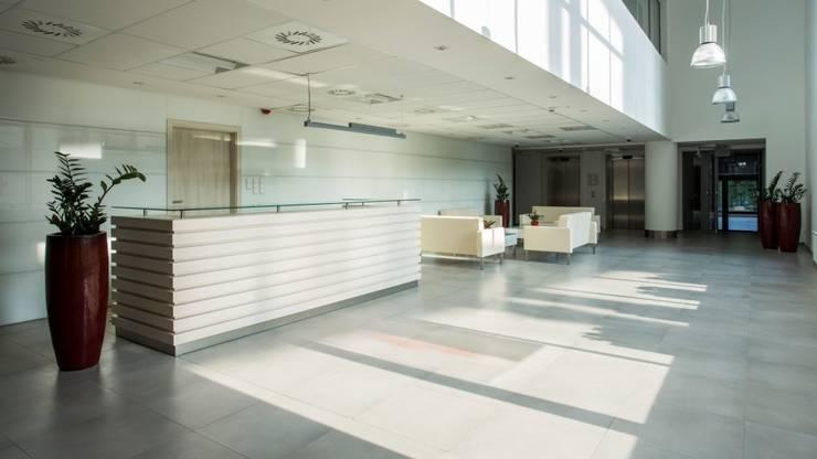 BUDYNEK BIUROWY RUPES SP Z O.O.: styl , w kategorii Biurowce zaprojektowany przez Kunkiewicz Architekci