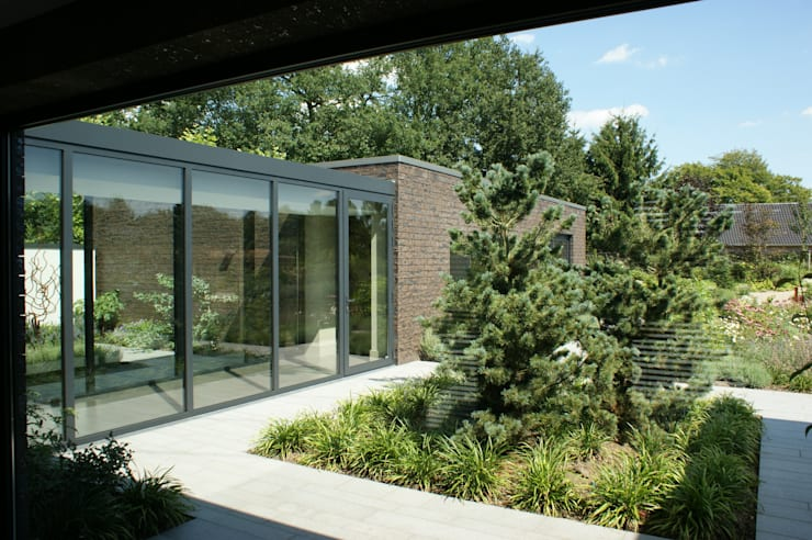 Stienestraat:  Huizen door Harold Laenen Architectuur, Modern