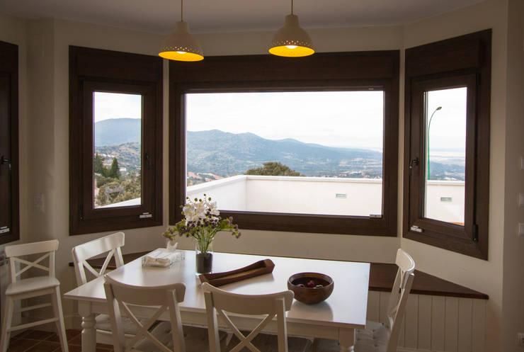 Bay window: Comedores de estilo  de Canexel