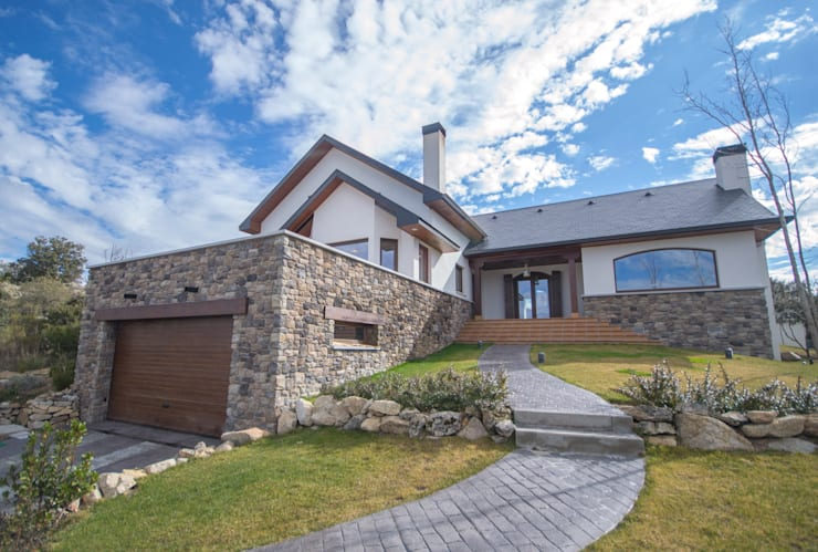 Casas de campo de estilo  por Canexel