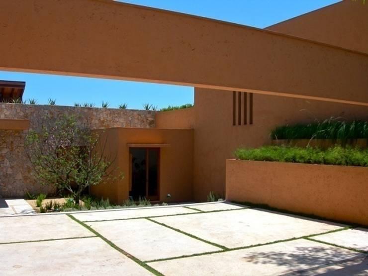 Residência Boa Vista: Jardins  por André Paoliello Paisagistas Associados