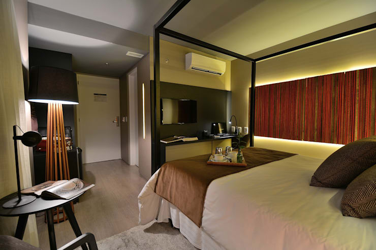 Apartamento Luxo Design: Salas de estar  por Bibiana Menegaz - Arquitetura de Atmosfera