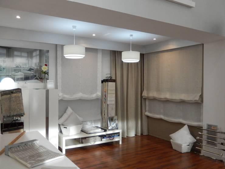 Estores Paquetto Las Rozas: Oficinas y Tiendas de estilo  de Luxaflex Concept Store