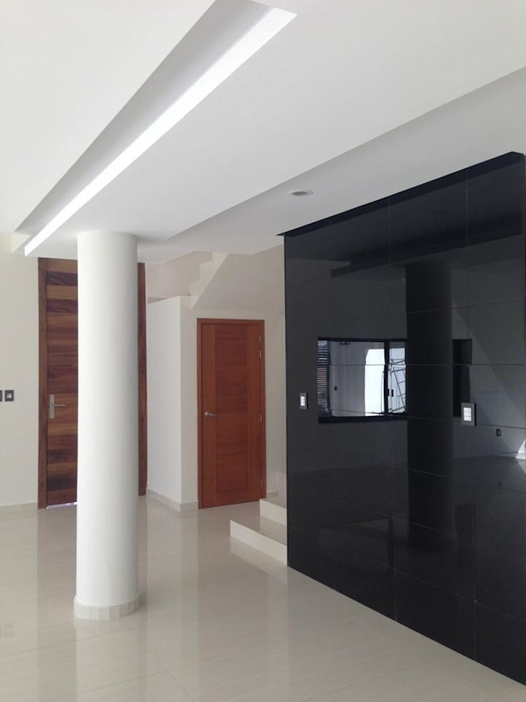 Pasillo PB: Pasillos y recibidores de estilo  por disain arquitectos