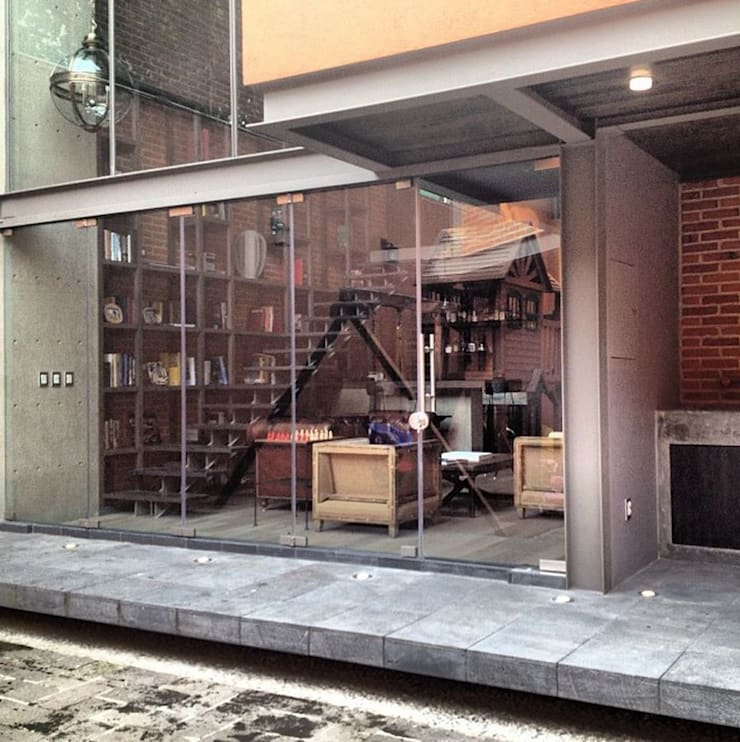 Fachada: Casas de estilo  por Quinto Distrito Arquitectura