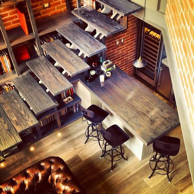 Biblioteca Higueras: Cocinas de estilo  por Quinto Distrito Arquitectura