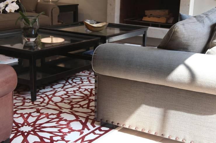 Sala principal: Salas de estilo  por Quinto Distrito Arquitectura