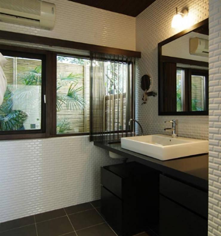 築40年の浴室がホテルライクのバスルームに: Style is Still Living ,inc.が手掛けた浴室です。