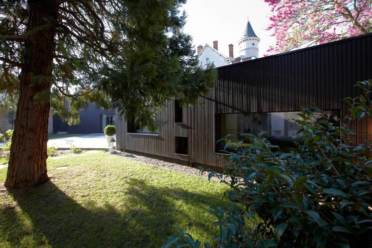 Maison individuelle à Villefranche-sur-Saône: Maisons de style de style Moderne par Caroline Wach Architecture