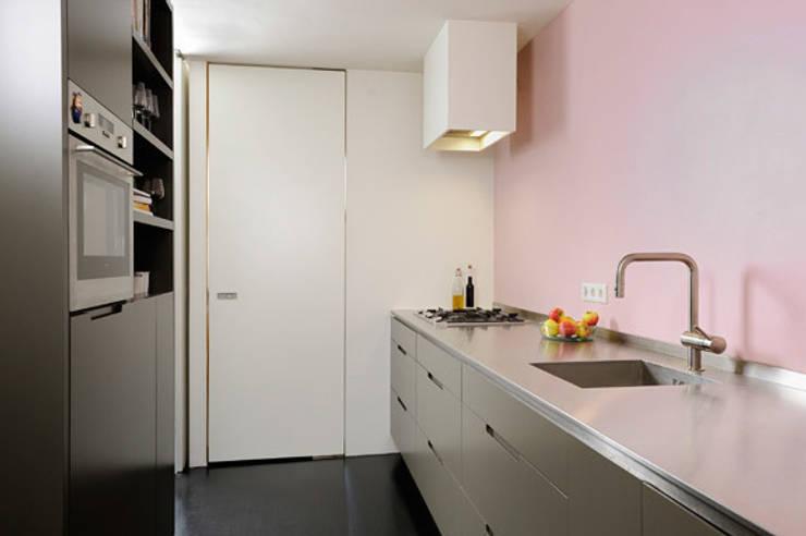 Cozinhas minimalistas por VEVS Interior Design