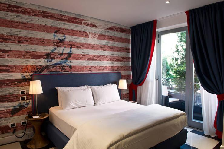 Hoteles de estilo  por Inkiostro Bianco