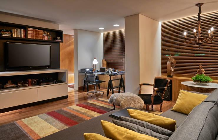 Apartamento AS: Salas de estar  por Beth Nejm