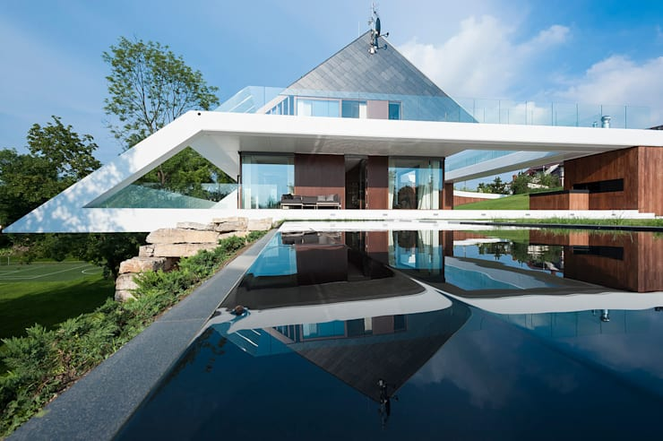 Casas de estilo  por MOBIUS ARCHITEKCI PRZEMEK OLCZYK