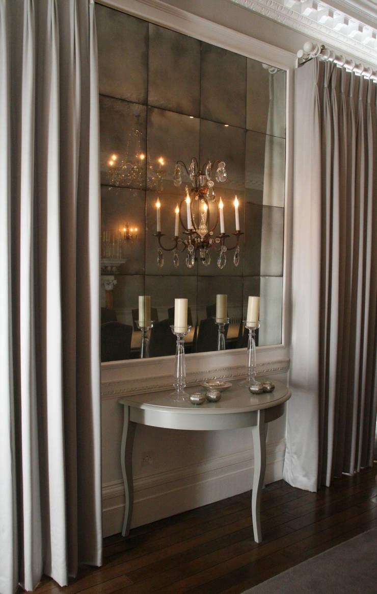 Mirrored Wall Installations:  Dining room by Rupert Bevan Ltd