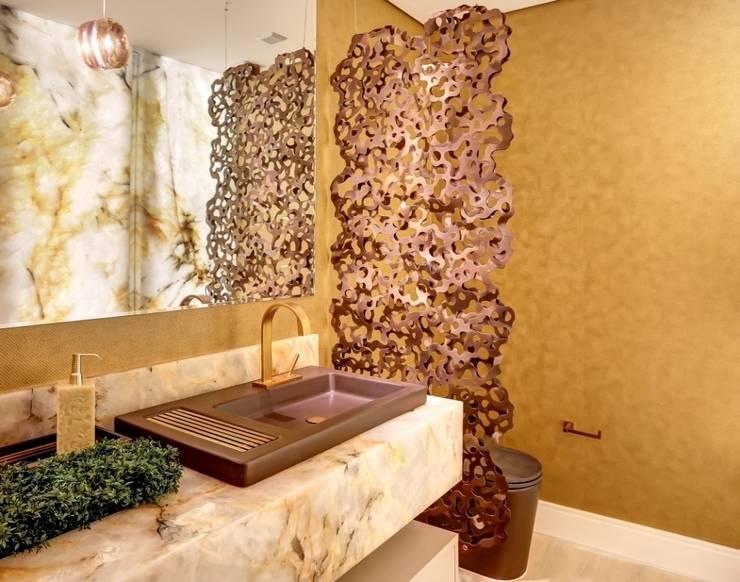 Lavabo sofisticado: Banheiros modernos por Marcia Debski Ferreira Designer de Interiores