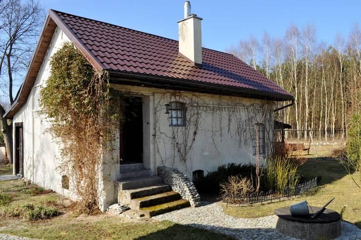 Casas de estilo rural por Grzegorz Popiołek Projektowanie Wnętrz