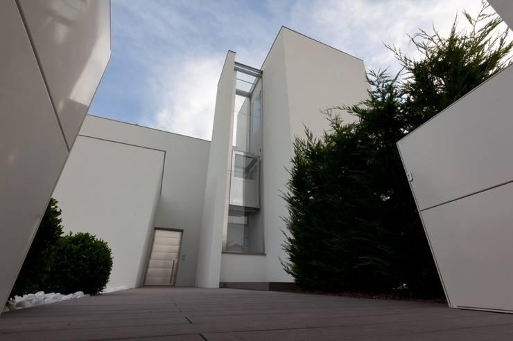 Villa urbana: Case in stile  di Paolo Carli Moretti Architetto