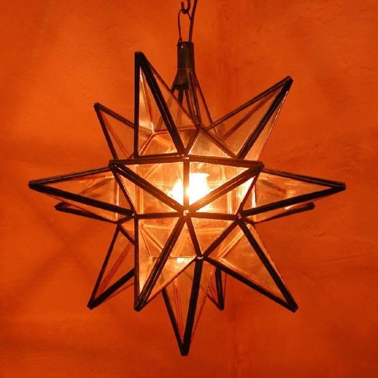 Marokańska lampa / gwiazda NASIMA TRANSPARENTNA: styl , w kategorii Miejsca na imprezy zaprojektowany przez DomRustykalny.pl