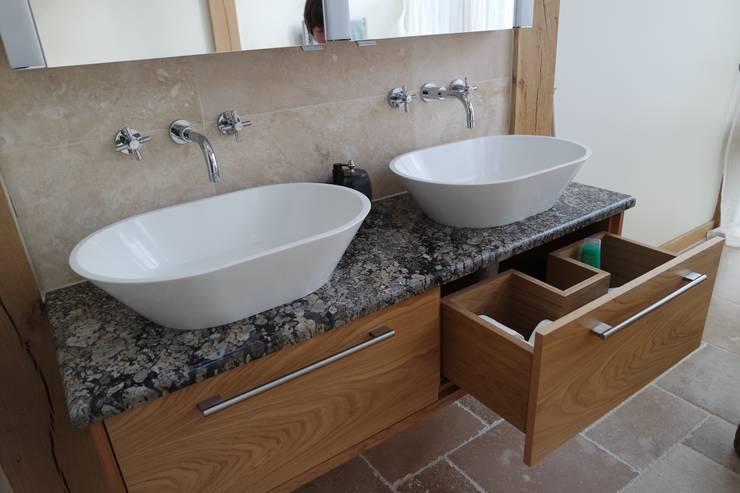 HAND BUILT BEDROOM AND EN-SUITE CABINETRY:  Bathroom by COOPER BESPOKE JOINERY LTD