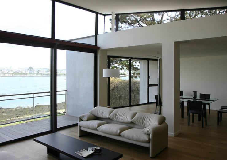 Salas de estilo  por Atelier de l'Ile