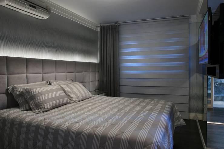 dormitório do casal: Quartos  por arquiteta aclaene de mello