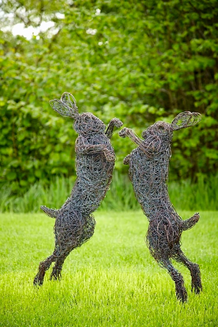 Mad March Hares in bronze wire :  Garden by Rupert Till