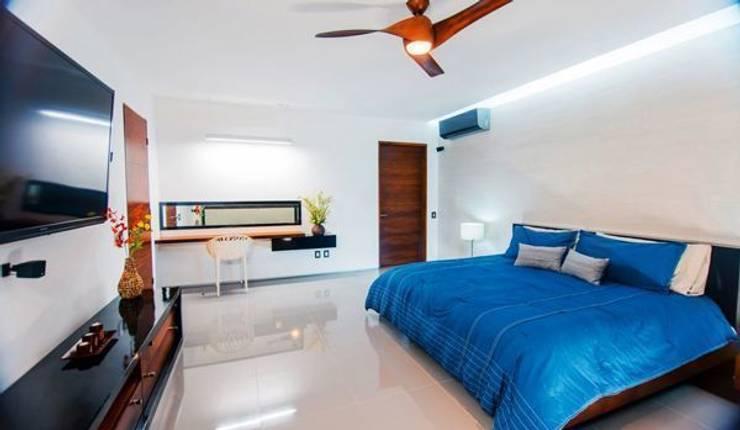 Casa Cocotera: Recámaras de estilo moderno por TAFF
