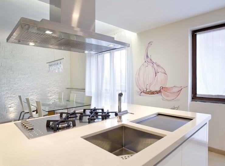 Cocinas de estilo clásico por Murales Divinos