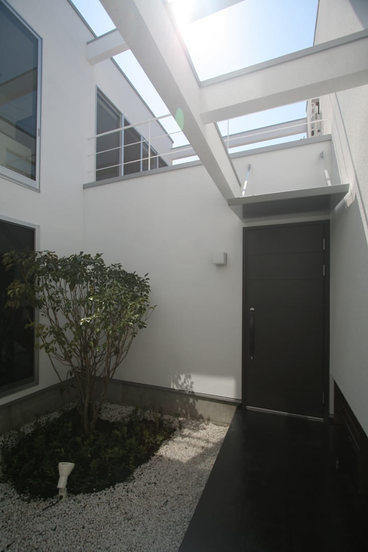 南足柄の家: 天工舎一級建築士事務所が手掛けた庭です。,