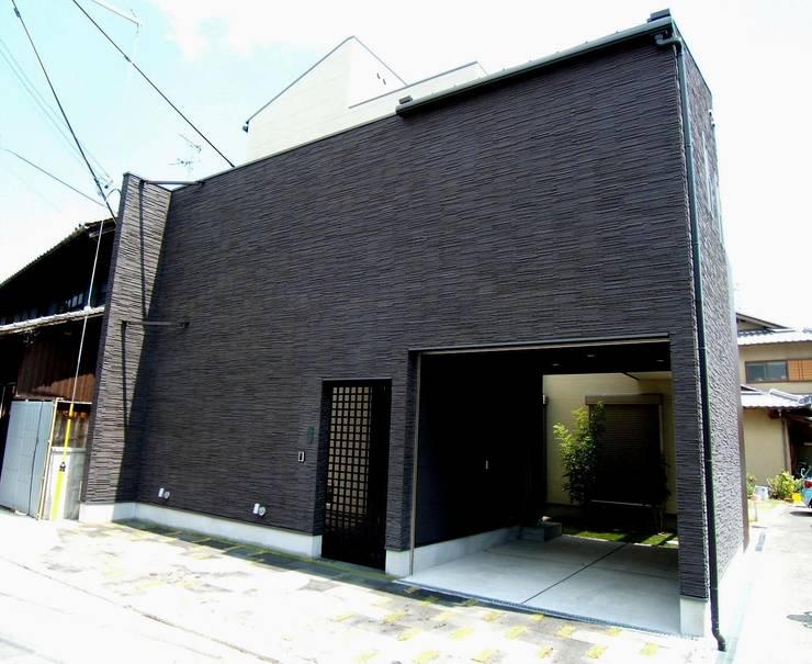 Casas de estilo  por OSM建築設計事務所